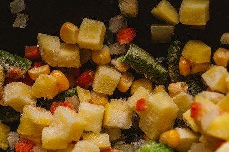 mixture: mixture of chopped vegetables and broccoli background. Stock Photo