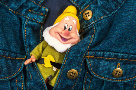 Structure of a background of jeans with a toy the gnome photo