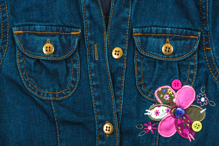 Jeans jacket with pockets and application of a flower photo