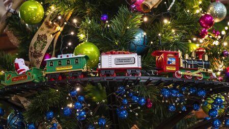 Christmas train with decoration and lighting on the Christmas tree.