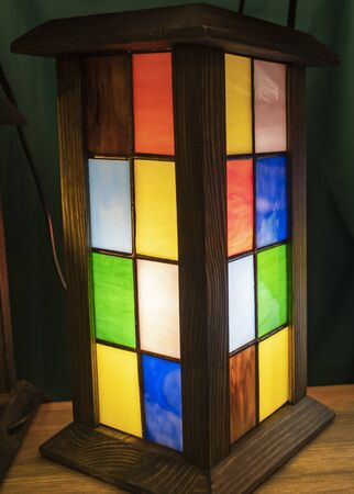 Charming table lamp in several different colors. Design of lighting fixtures.
