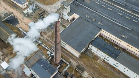 Aerial view smoking chimney of the gas boiler plant. Ecological problem.