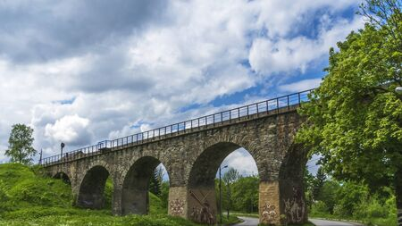 The old Austrian operating railway viaduct in the resort village of Vorokhta. Ukraine. Carpathians