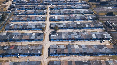 Aerial view of many garages for parking cars in sleeping district of the city. Aerial panoramic view. Parking concept. Stock Photo