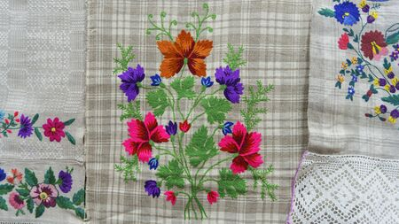 Embroidered good like handmade cross-stitch ethnic Slavic pattern. Towel with ornament. Folk concept. Stock Photo