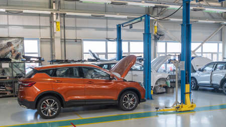 Automobile manufacturers, neatly arranged new cars are ready to leave the factory.