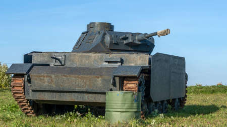 Vintage German World War 2 armored heavy combat tank poised on the battlefield. Model of German tank of the Second World War.