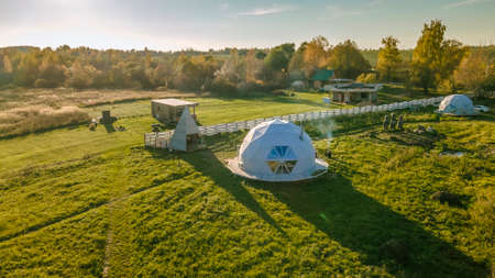 Spherical house in the village. Round house, geometric design for summer vacation. Unusual real estate. Gorgeous dome home of the future. Foto de archivo