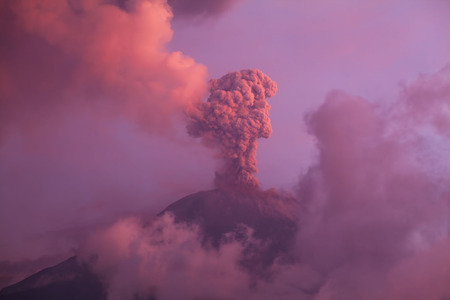Tungurahua volcano explosion on february 2014 at sunset photo