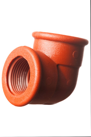 Isolated pipe fitting, studio shot photo