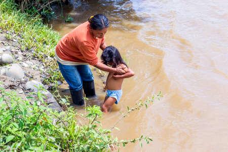 National Park Yasuni Ecuador November 2012 Indigenous family mother and dauther bath time