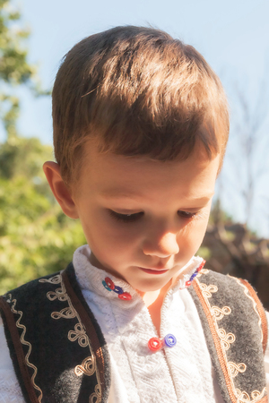 peasant: Portrait Of A Romanian Peasant Child Dressed In Traditional Romanian Costume