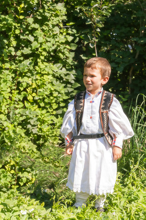 ethnology: Romanian Peasant Child Who Has Two Years Old Posing In Traditional Costume Stock Photo