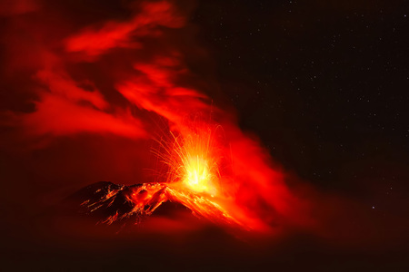 strombolian: Powerful Explosion Of Tungurahua Volcano At Night, South America Stock Photo