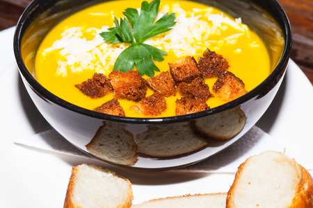 crouton: Vegetarian Squash Soup With Parsley, Crouton And Grated Cheese