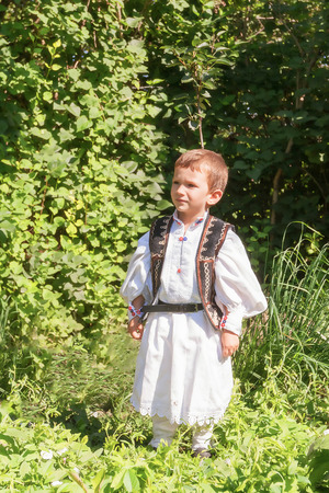 romanian: Romanian Peasant Child Proud Of His Traditional Romanian Costume Stock Photo