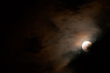 lunar eclipse: Full Moon Shining In The Darkness Sky, Lunar Eclipse Stock Photo