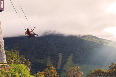 tungurahua: Silhouette Of An Young Happy Woman On A Swing, Swinging Over The Andes Mountains, Tree House, Ecuador