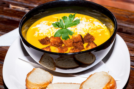 crouton: Vegetarian Pumpkin Soup With Parsley, Crouton And Grated Cheese