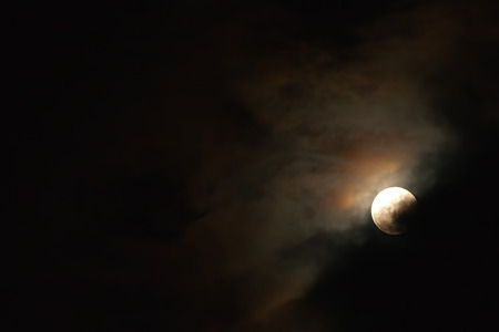 phase: Moonlight, Blood Moon Phase On The Dark Cloudy Sky Stock Photo