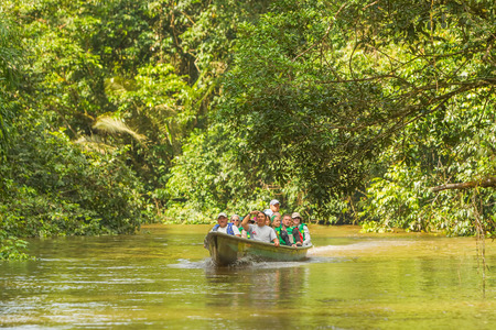 humid south: Cuyabeno, Ecuador - 20 March 2015: European Biologists In The Canoe Crossing Cuyabeno River, South America In Cuyabeno On March 20, 2015