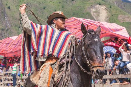 layman: Banos, Ecuador - 30 November 2014: Young Latin Cowboy Riding A Horse, The Most Impressive And Affordable Horse Rides In Ecuador, South America In Banos On November 30, 2014