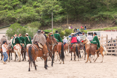 show time: Banos, Ecuador - 30 November 2014: Group Of Young Latin Men Riding Horses Expecting Show Time, Local Competition, South America In Banos On November 30, 2014