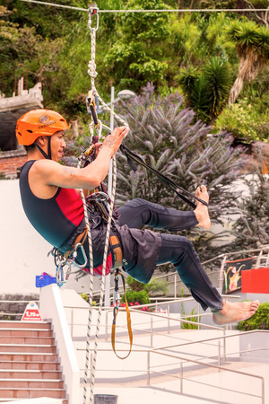 carabineer: Banos, Ecuador - 23 May 2015: Unidentified Hispanic Climber Training For Climbing Rope Competition In Banos On May 23, 2015