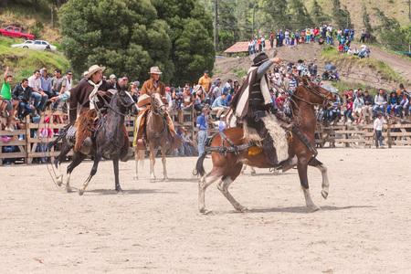 layman: Banos, Ecuador - 30 November 2014: Group Of Latin Indigenous Cowboys Riding A Horse, South America In Banos On November 30, 2014 Editorial