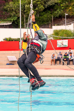 carabineer: Banos, Ecuador - 23 May 2015: Exercise Climbing Rescue, Demonstration Of A Sports Guide In A Public Competition In Banos On May 23, 2015