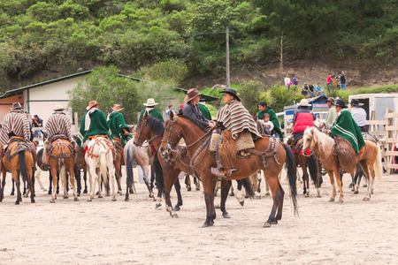 show time: Banos, Ecuador - 30 November 2014: Group Of Young Latin Men Riding Horses Expecting Show Time, South America In Banos On November 30, 2014 Editorial