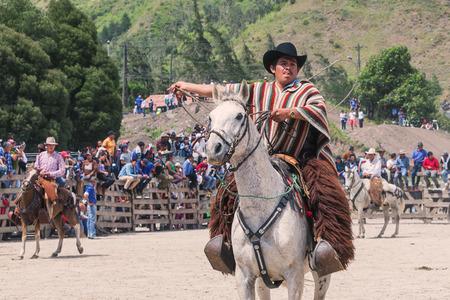 public demonstration: Banos, Ecuador - 30 November 2014: Young Latin Cowboy Is Riding A Horse, Public Demonstration In South America In Banos On November 30, 2014