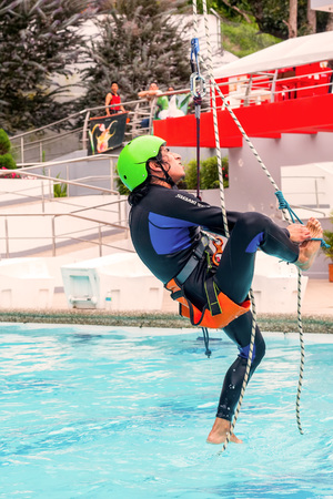 rappel: Banos, Ecuador - 23 May 2015: Unidentified Athletic Young Man Climbing A Rope, Ecuadorian Sorts Competition In Banos On May 23, 2015