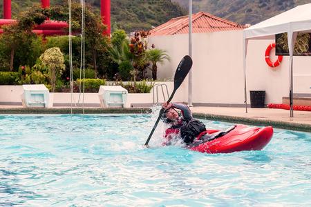 intentional: Banos, Ecuador - 23 May 2015: Kayaker Performing An Intentional Kayak Roll In A Swimming Pool In Banos On May 23, 2015 Editorial