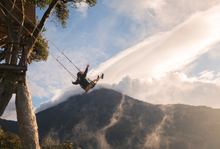 adventurous: Adventurous Woman Taking A Ride On The Swinging Seat At Casa Del Arbol, Ecuador, South America