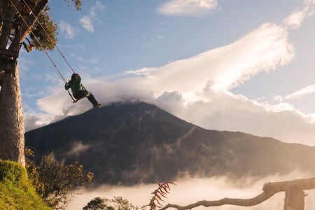 tungurahua: Courageous Teenager Swinging On A Unique Swing At Casa Del Arbol, Ecuador