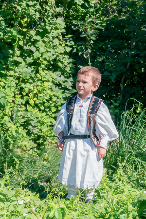ethnology: Romanian Peasant Child Proud Of His Traditional Romanian Costume Stock Photo