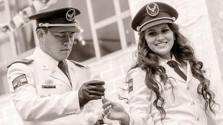 prefix: Banos De Agua Santa, Ecuador - 29 November 2014 : Black And White Portrait Of Young Woman And Man Wearing The Uniform Of Navy In Banos De Agua Santa On November 29,