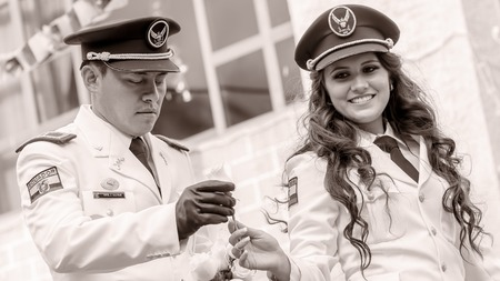 Banos De Agua Santa, Ecuador - 29 November 2014 : Black And White Portrait Of Young Woman And Man Wearing The Uniform Of Navy In Banos De Agua Santa On November 29,