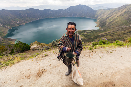 Quilotoa, Ecuador - 27 March 2015: Indigenous Villager Smiling At The Camera, Quilotoa, South America In Quilotoa On March 27, 2015 Stock Photo - 60038445