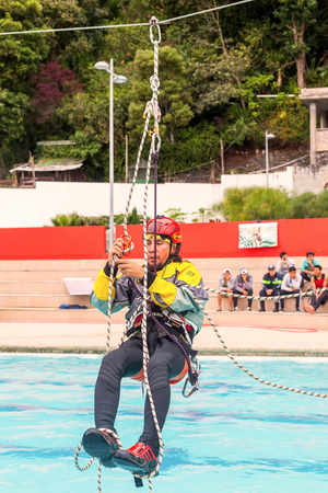 rappel: Banos, Ecuador - 23 May 2015: Climbing Is The Activity Of Using Ones Hands, Feet, Or Any Other Part Of The Body To Ascend A Steep Object In Banos On May 23, 2015