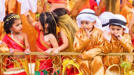 national geographic: Banos,  Ecuador - 29 November 2014: Beautiful Group Of Latin American Kids Celebrating On City Streets Of Banos De Agua Santa, South America In Banos On November 29, 2014