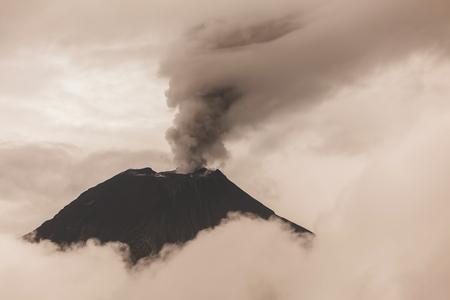 spews: Aerial View Of Tungurahua Volcano Spews Molten Rocks And Column Of Gas And Ash, Ecuador Stock Photo