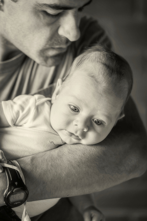 paternal: Latin American Father Holding Newborn Baby Boy In His Arms, Monochrome Shoot