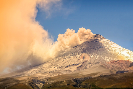 erupting: Beautiful Sunset View Of Magnificent Cotopaxi Volcano Erupting In Ecuador, South America