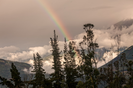 tungurahua: Mountain Landscape With A Rainbow Over Tungurahua Volcano, Ecuador, South America