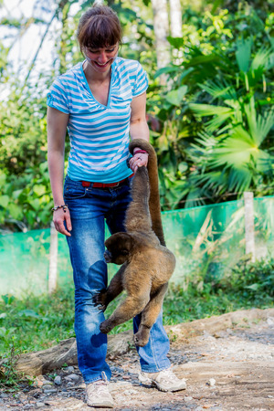 Beautiful European Woman Playing With A Monkey On The Rescue Center In Ecuador, South America