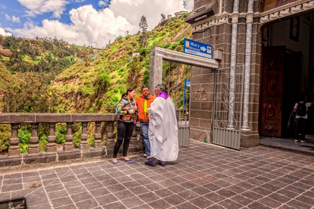 confessing: Ipiales, Ecuador - 11  September 2016: Religious Couple Is Confessing To A Priest At Las Lajas Sanctuary A Basilica Church Located In The Southern Colombia, South America