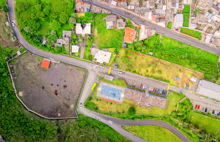 Aerial City View With Buildings And Parking Lots Of Banos De Agua Santa, Tungurahua Province, In The Daylight, South America