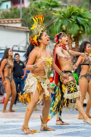 Banos De Agua Santa, Ecuador - 29 November 2014: Group Of Traditional Huaorani People Performing Folk Dance On The Streets Of Banos De Agua Santa, South America, Christmas Holiday On November 29, 2014